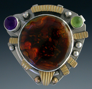 Ring, Silver and 14K Gold set with Fire Agate, Amethyst and Peridot.