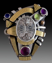 Ring, Silver and 14K Gold set with White Topaz, Garnet, Amethyst, Peridot and Iolite.