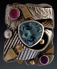 Ring, Silver and 14K Gold set with Blue Topaz, Garnet and Amethyst.