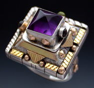 Ring, Silver and 14K Gold set with White Amethyst, Peridot and Garnet.