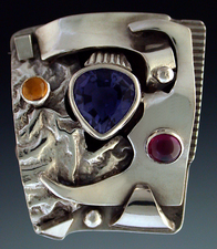 Ring, silver set with Iolite, Garnet and Citrine.