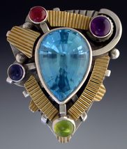 Ring, Silver and 14k gold set with Blue Topaz, Amethyst, Iolite, Garnets, and Peridot.